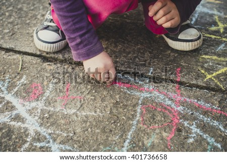 Children playing with colored chalks