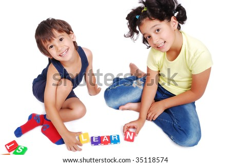 Children playing with cubes in white isolated space