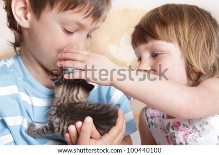 children playing with kitten at home