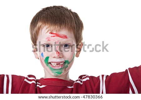 Children playing with paint, with painted face