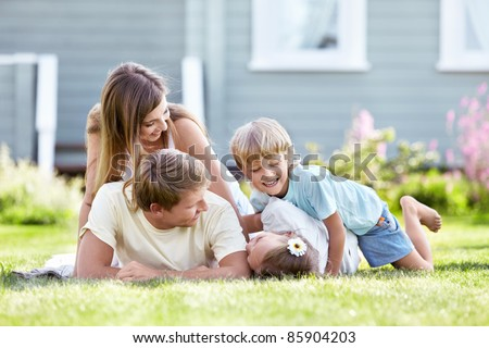 Children playing with parents in the garden