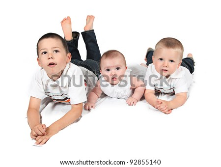 Children posing for family photo together on white - stock photo