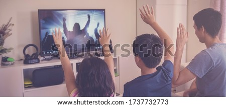 Photo of  Children praying with father parent , family and kids worship online together at home, streaming church service, social distancing, lockdown concept