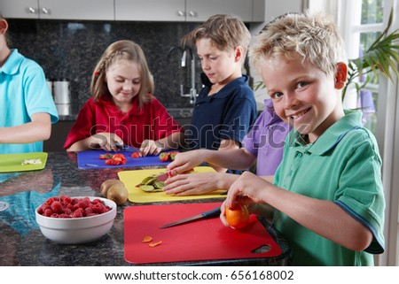Children preparing food stock photo
