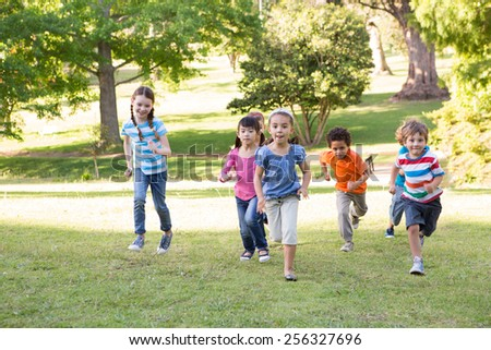 Children racing in the park on a sunny day #256327696