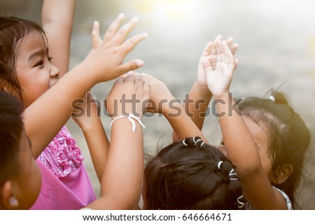 children raise hands and...