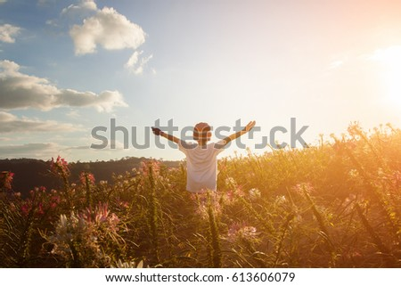 children raise their arms up to the sky. They feel free