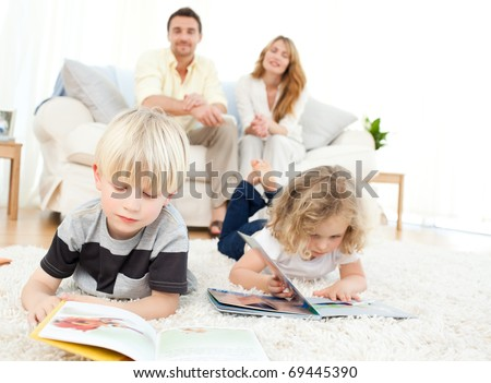 Children reading books in the living rooms