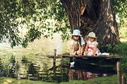 Children rest and play on the lake.