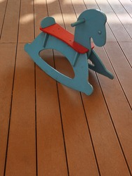 children rocking horses for decoration and playground concept Retro photo effect