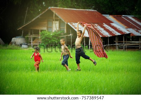 children runing in the backyard ...