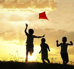Children running with kite