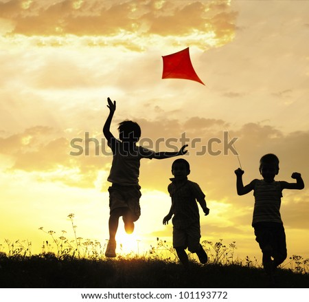 Children running with kite - stock photo