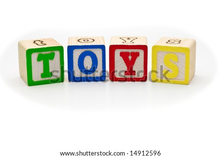 Children's alphabet letters wood blocks spelling the word toys, on white background