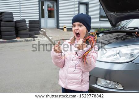 Children's auto mechanic working in garage. Car service. Repair service.