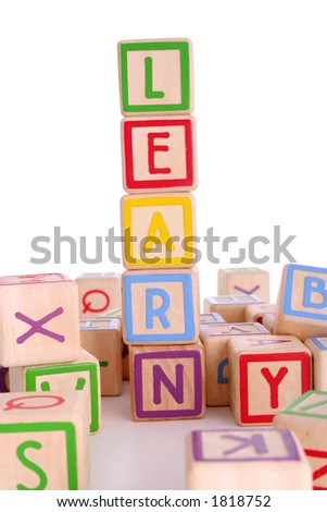 Children's colored blocks spelling the work learning and surrounded by other blocks - has clipping path