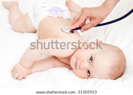 Children's doctor exams infant with stethoscope