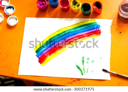 Children\'s drawing - rainbow and several open cans of paint