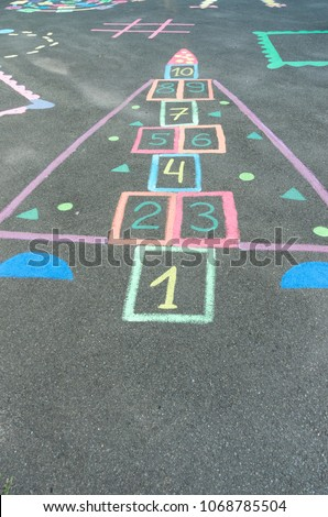 Children's drawings on the asphalt. Drawings with colorful crayons. #1068785504