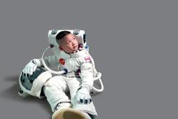 Children's dream job. Kids Dream Jobs Diversity Occupations. Little boy in space suit. Kid in space suit. Astronaut boy sitting.