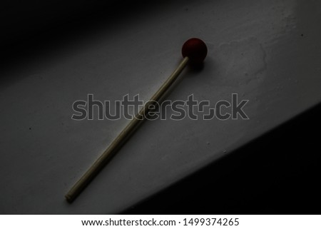 Children's drumstick on a windowsill in the evening