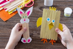 Children's easter gift from wooden chopsticks toy chicken and Easter bunny. Hand-made. The project of children's creativity, needlework, crafts for children.