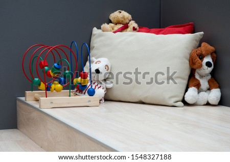Children's educational and soft toys are in the corner. Kids corner in the apartment #1548327188