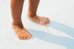 Children's feet in the water