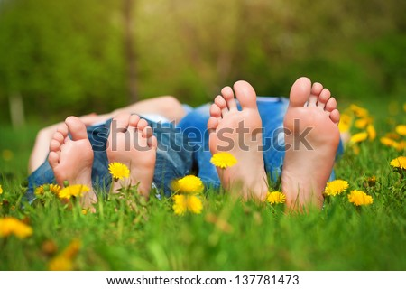 Children's feet on grass Family picnic in park