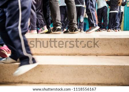 children's feet over elementary school hallways and stairs #1118556167