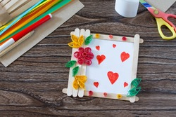 Children's gift from wooden sticks photo frame, birthday greeting card. Copy space. Handmade. Project of children's creativity, handicrafts, crafts for children.