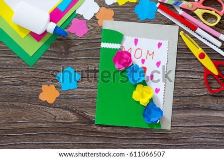 Children's gift. Greeting card greeting card with flowers on Matter Day with the inscription of Mom. Children's art project, craft for children. Handmade. Copy space. #611066507