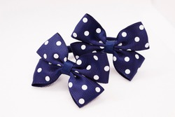 Children's hair accessories. Blue bow with white peas