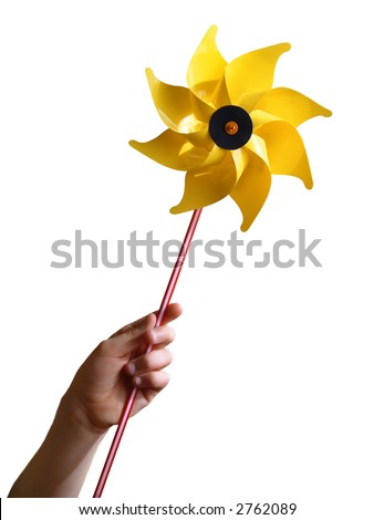 Children's hand holding a yellow toy windmill, isolated in white background