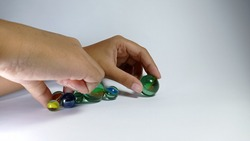 children's hands play marbles. suitable for design elements on the theme of games, education, home activities, and recreation
