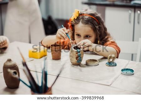 children\'s hands sculpts clay crafts pottery school
