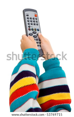 children's hands with a remote control on a white background