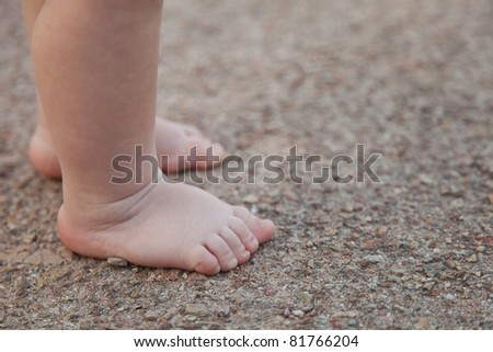 Children's legs walk along track