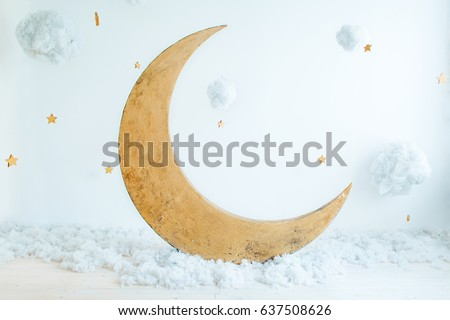 Children's location for a photo shoot: the moon with stars and clouds. A place for dreams