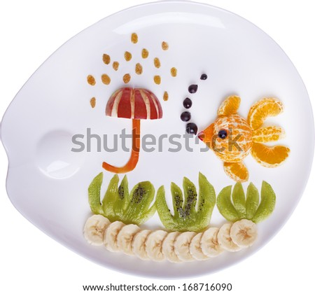 "Children's meal from fruits ""Golden fish"" - stock photo"