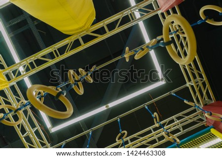 Children's obstacle course. Rings, cylinders and supporting structures. Selective focus #1424463308