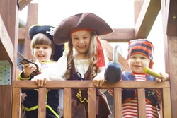 Children's party in pirate style. Children in pirate costumes are playing on Halloween.