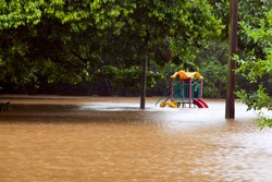 Children's playground under water after heavy rain and flooding in Queensland Australia