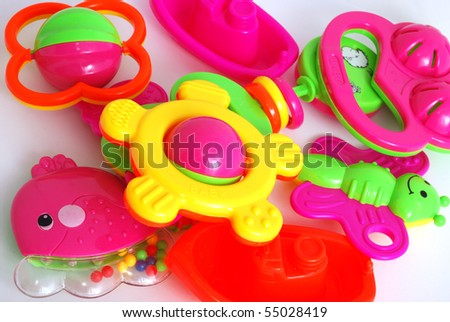 Children's rattle from plastic on a white background