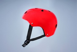 Children's red bicycle helmet on a plain background