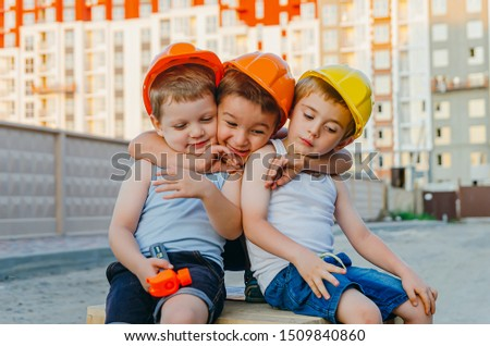 Children's role-playing games - a profession builder. Early development of the child, ideas for the game. A team of builders with tools at a construction site. Fun time with friends #1509840860