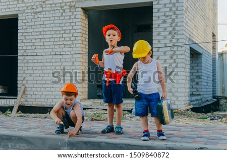 Children's role-playing games - a profession builder. Early development of the child, ideas for the game. A team of builders with tools at a construction site. Fun time with friends #1509840872