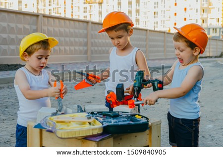 Children's role-playing games - a profession builder. Early development of the child, ideas for the game. A team of builders with tools at a construction site. Fun time with friends #1509840905