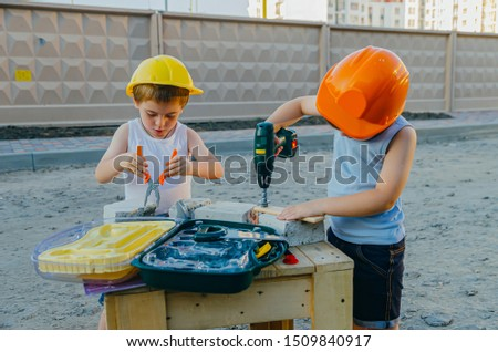 Children's role-playing games - a profession builder. Early development of the child, ideas for the game. A team of builders with tools at a construction site. Fun time with friends #1509840917