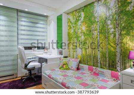 Children's room with wallpaper mural photo